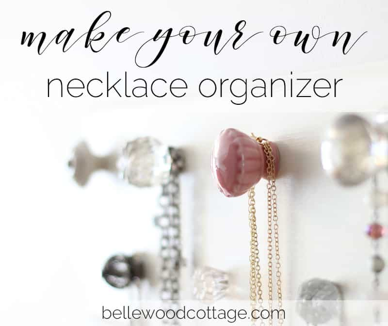 A necklace organizer made with knobs from Hobby Lobby.