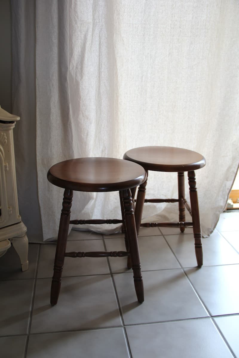 Two old dark wooden stools.