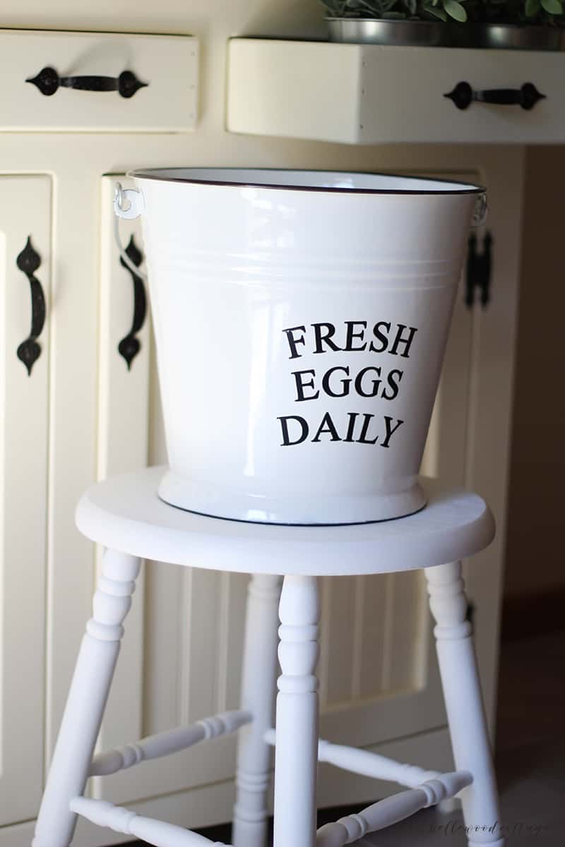 A farmhouse stool painted with white chalk paint.