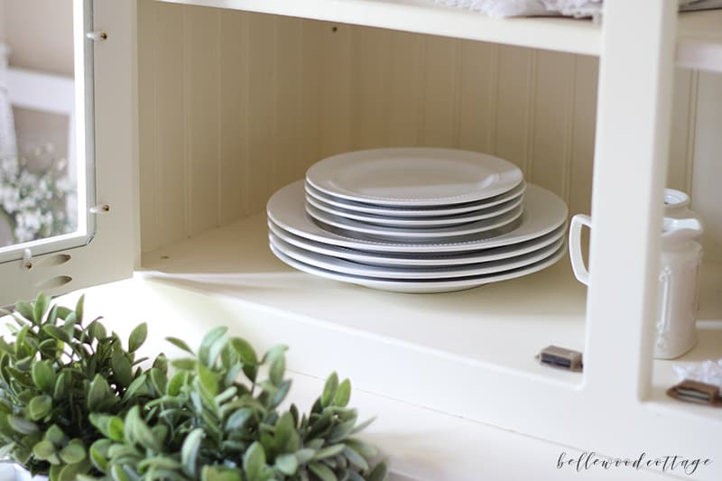 how to style a hutch - classic white dishes and greenery