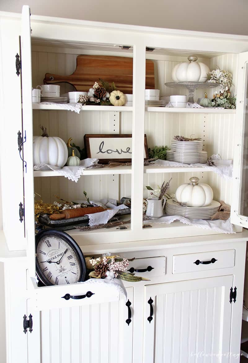 Learn how to maximize your decorating budget and use the decor you already own to style a beautiful fall farmhouse hutch | from Bellewood Cottage