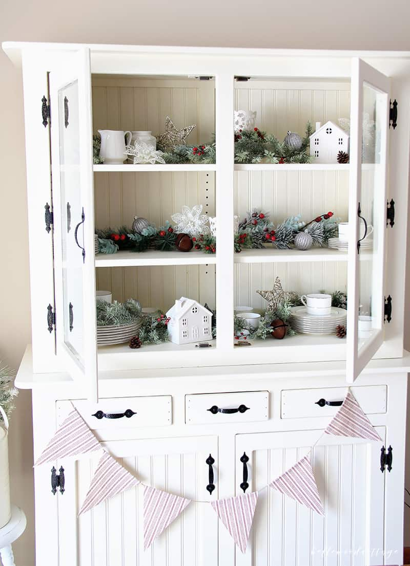 A farmhouse hutch is a beautiful centerpiece for any room. Learn how to style and decorate your hutch for Christmas with these budget-friendly tips! | Bellewood Cottage |