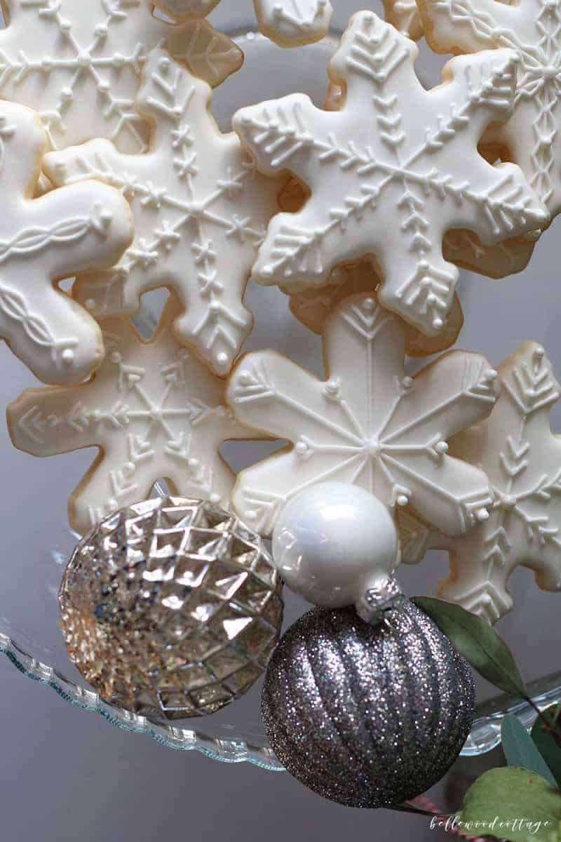 Much like a gingerbread house, sugar cookies decorated with royal icing can become a festive part of your Christmas decor. From Bellewood Cottage.