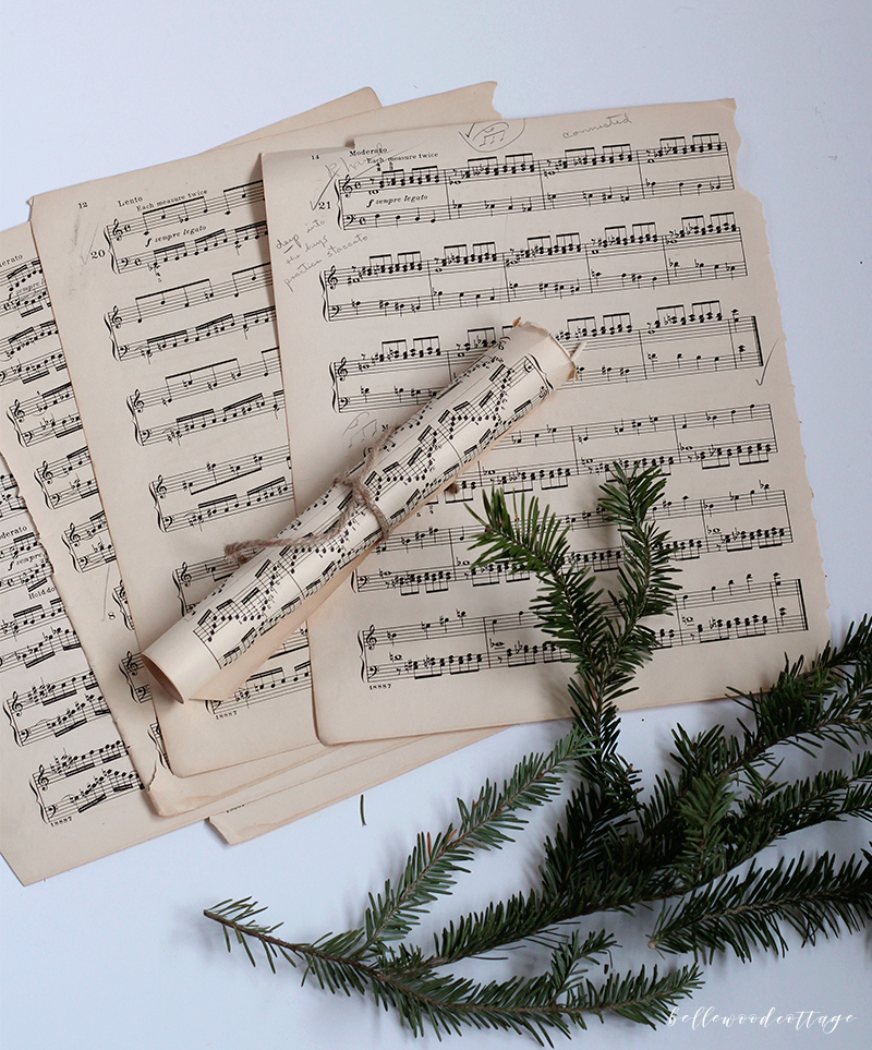 Get inspired to create pretty DIY Christmas decorations with this easy idea for incorporating sheet music decor and fresh pine into your homemade Christmas!