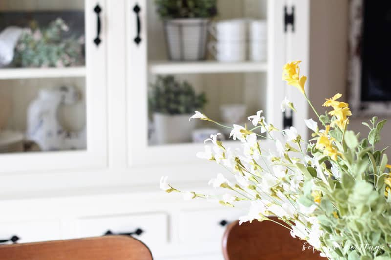 Learn how to bring the spring season into your home (even if the weather isn't cooperating!) with my simple tips on how to style a hutch for spring!