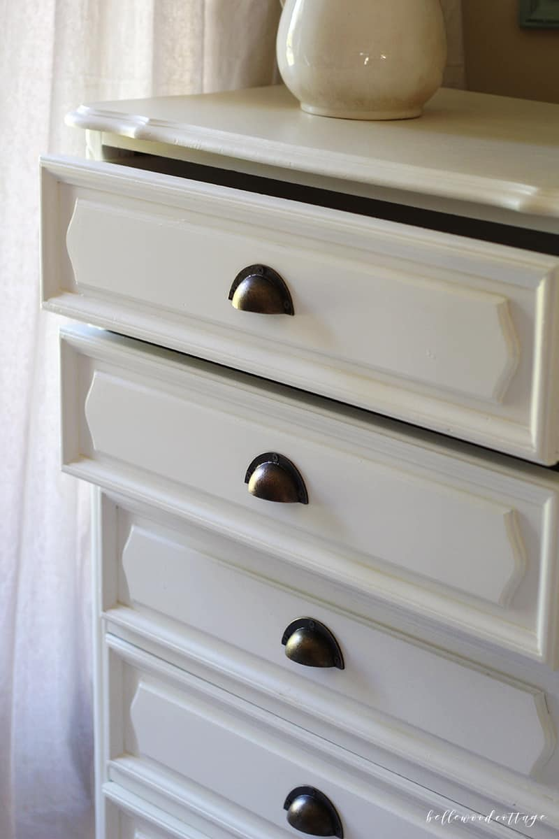 A white dresser painted with chalk paint.