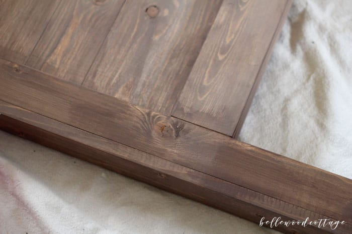 Learn my technique for how to use milk paint as a stain, as seen on my DIY Farmhouse Headboard. An easy (and non-toxic!) way to stain wood! #BellewoodCottage #diytutorial #milkpaint #mmsmp #nontoxicpaint