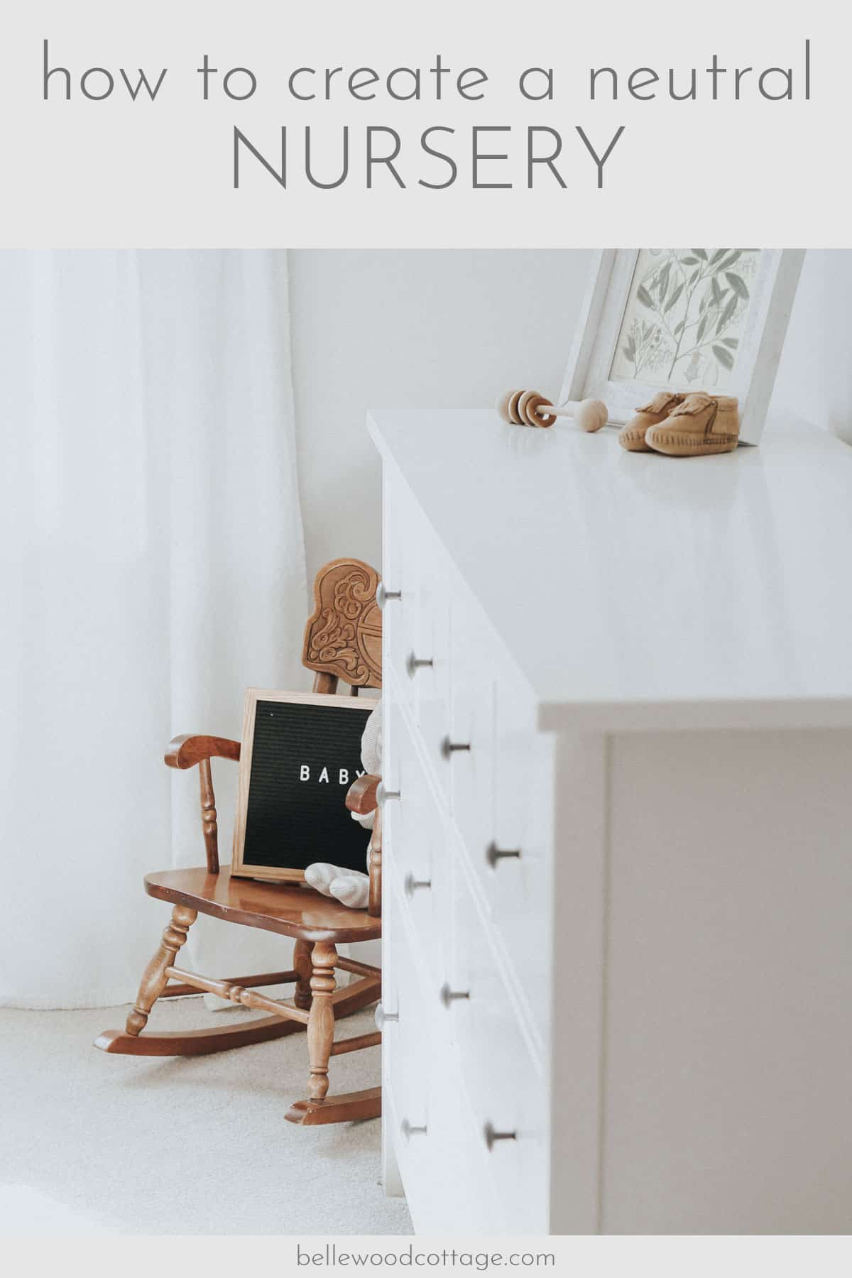 "Rocking chair with a letter board with the word ""baby"" on it in a neutral nursery."