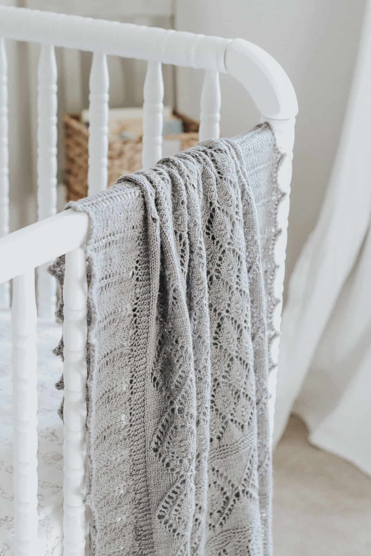 Close up view of heirloom knit blanket on a Jenny Lind crib.