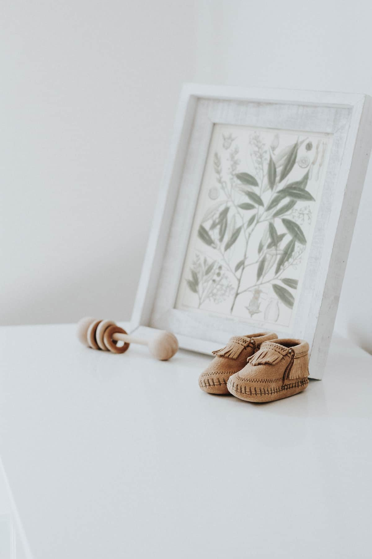 Moccasins and a wooden baby rattle.