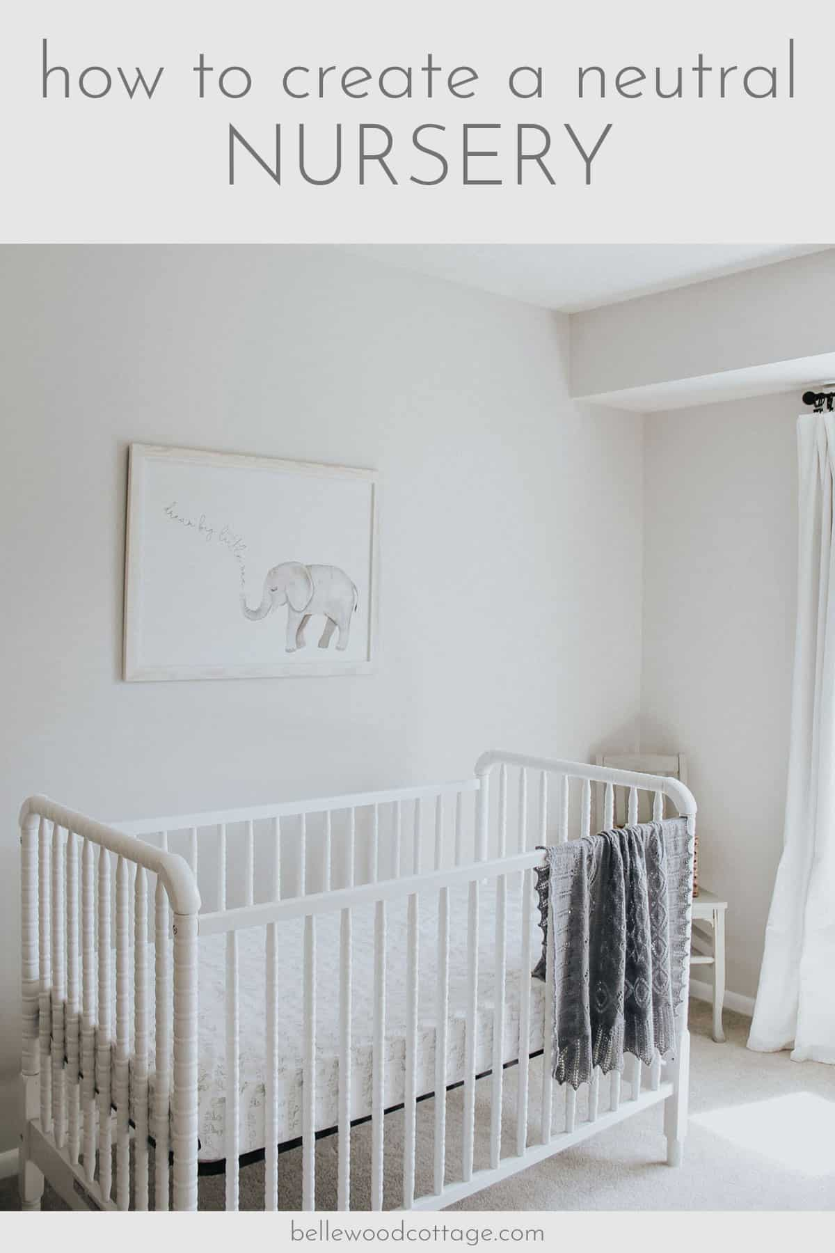 Jenny Lind crib, elephant art, and hand knit heirloom blanket in a gray nursery.