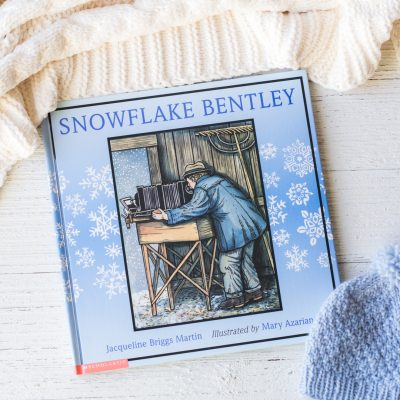 The picture book, Snowflake Bentley, unopened on a wooden surface.