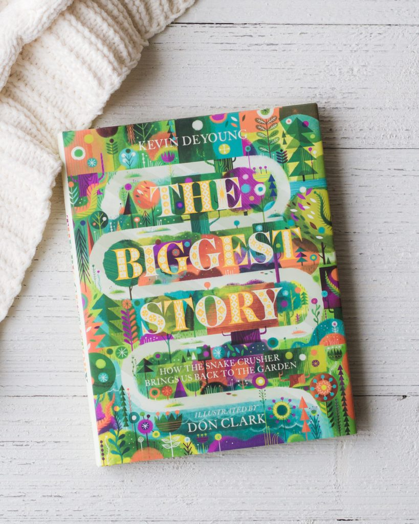 The Biggest Story book on a wooden surface.