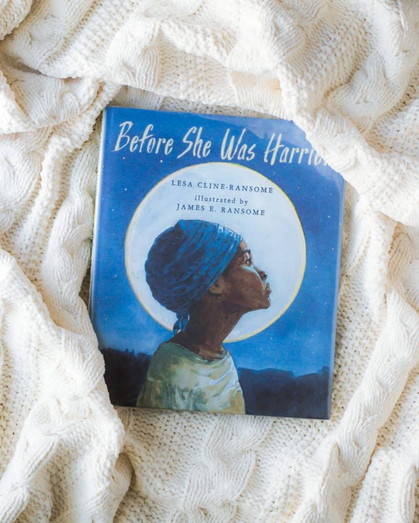 Before She Was Harriet picture book on a white knit blanket.