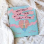 A photo of the picture book, Somebody Loves You, Mr. Hatch, on a wooden surface.