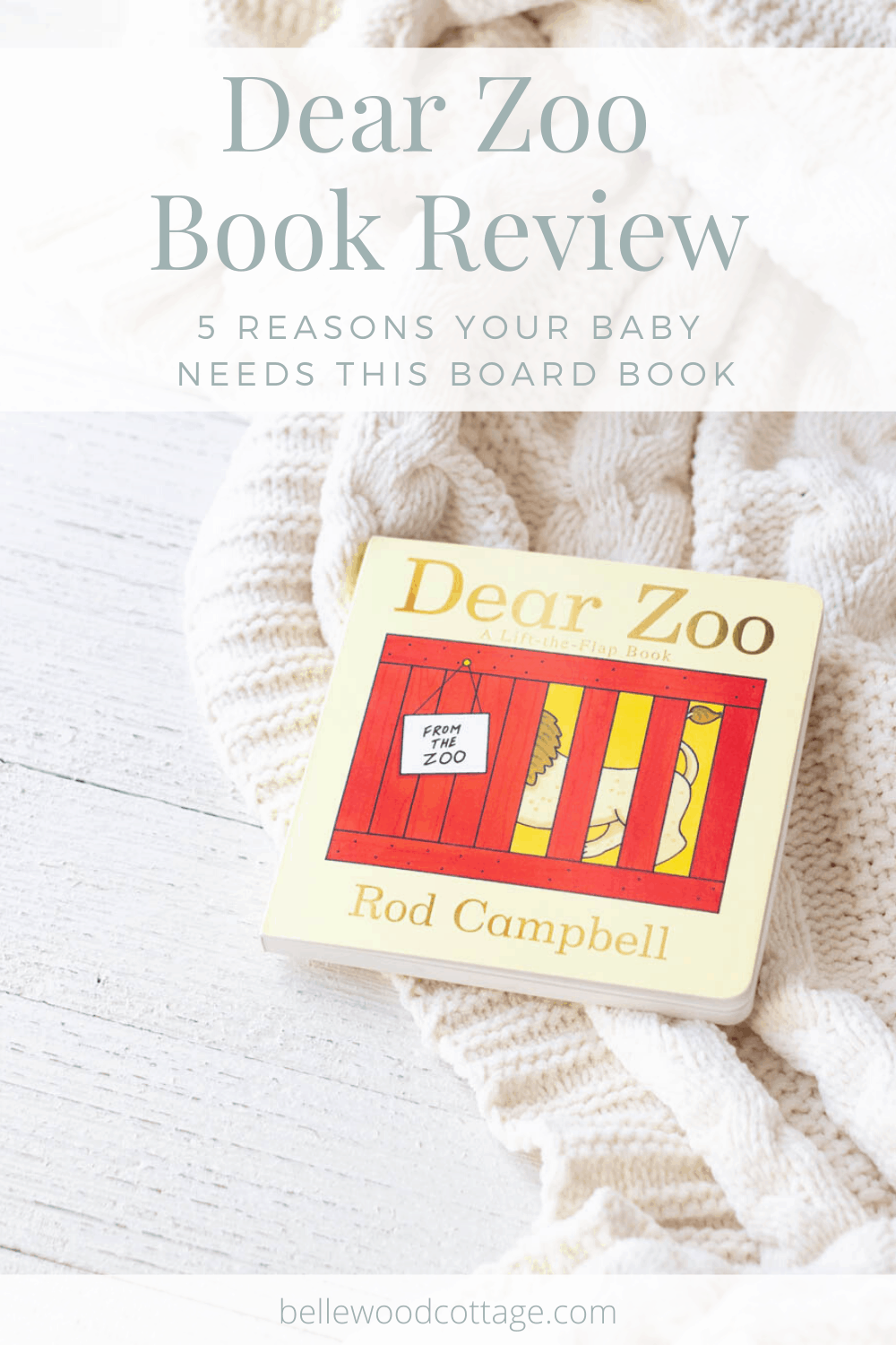 A board book copy of Dear Zoo by Rod Campbell on a wooden surface.