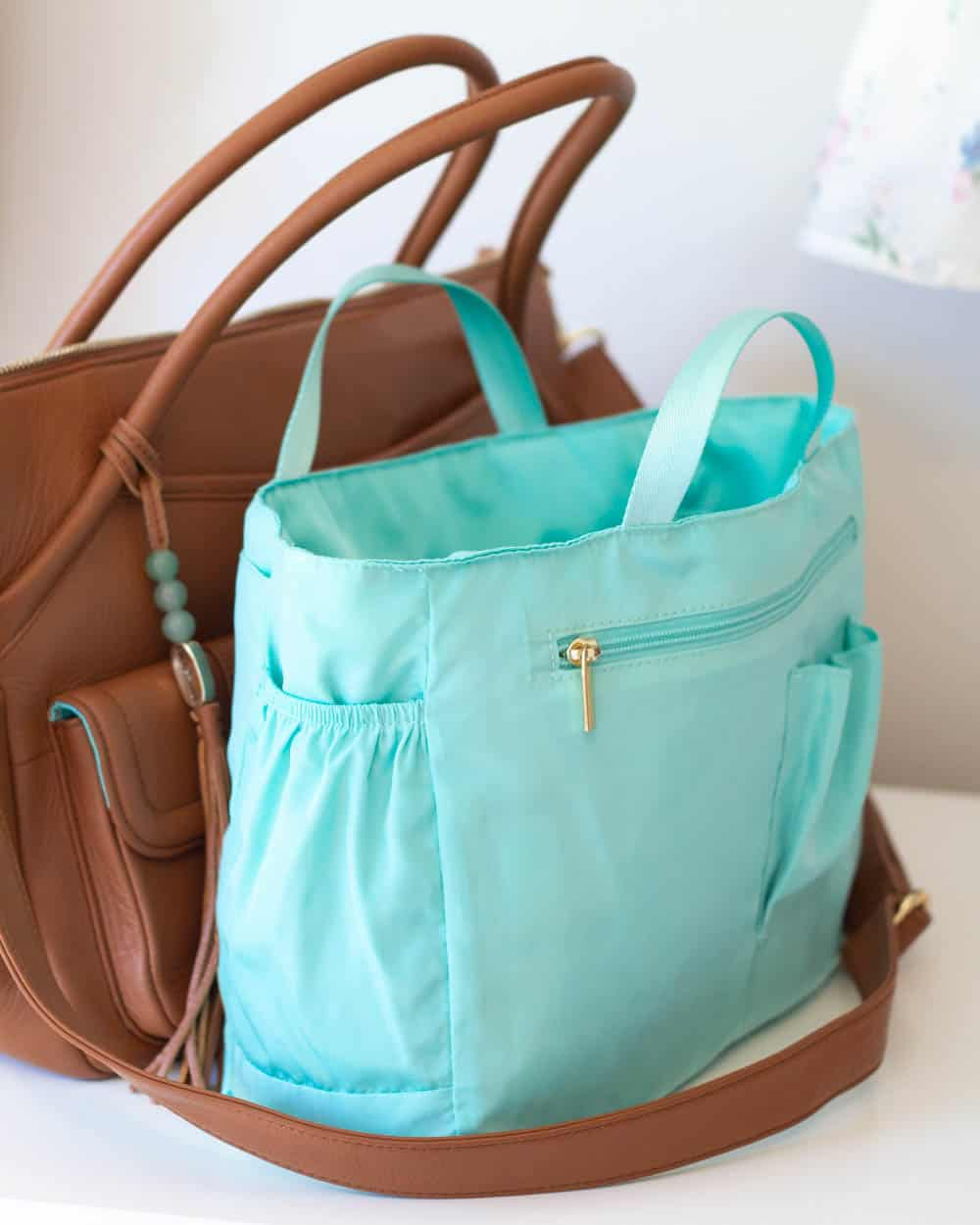 The bright jade colored organizer insert from a Lily Jade diaper bag.