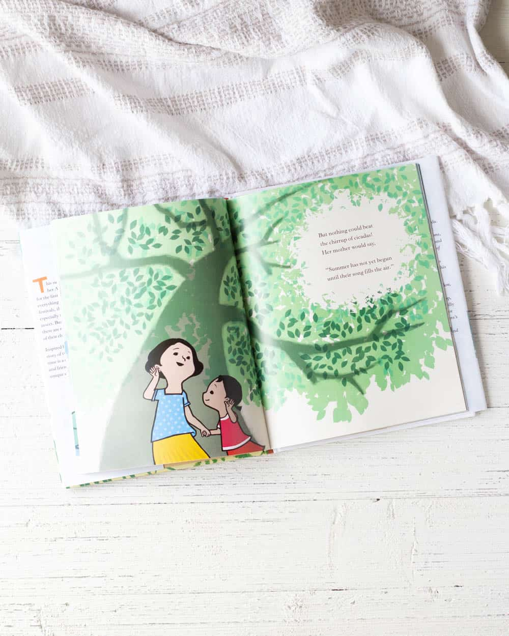 A picture book on a wooden background.