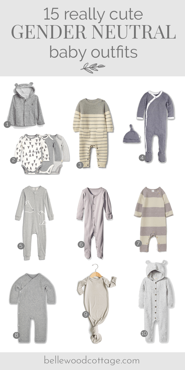 A selection of gender neutral baby clothes on a white background.