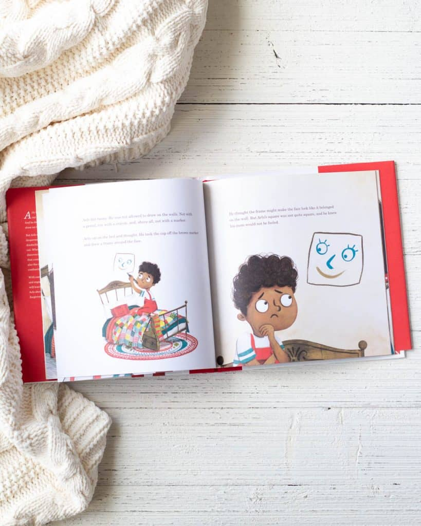 A new kids' book, Arlo and the Great Big Cover-Up, on a wooden background.