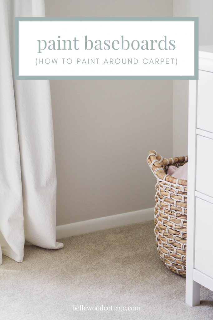 "Painted white baseboards in a nursery with overlaid text, ""Paint Baseboards (How to Paint Around Carpet)"""