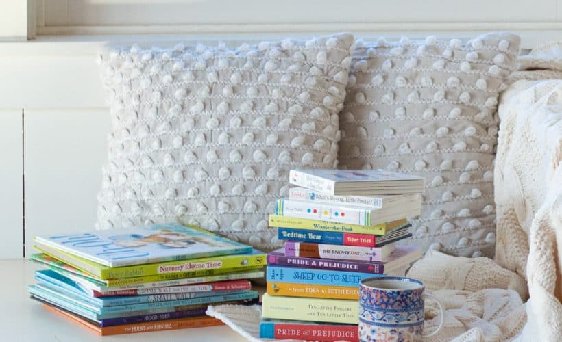 Stacks of books on a window seat.