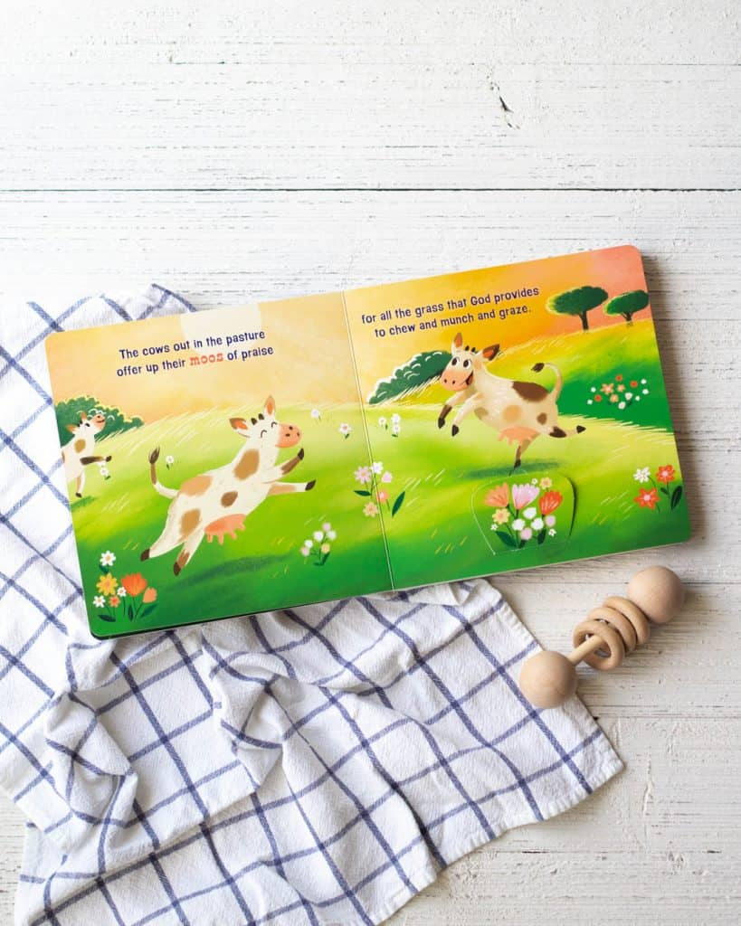 An illustration of cows jumping around in their pasture from a toddler board book, The Great Farmapalooza.