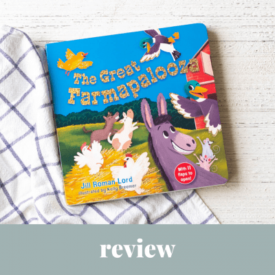 A new board books for kids, The Great Farmapalooza, on a wooden background.