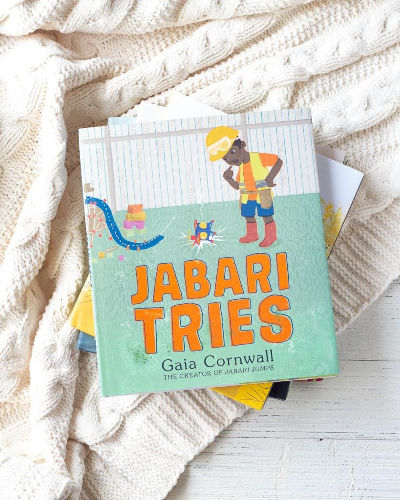 A children's picture book, called Jabari Tries, on a stack of other colorful picture books.
