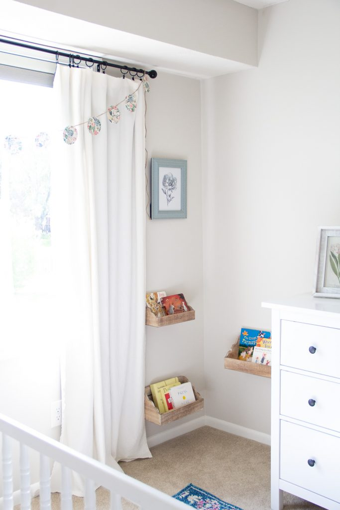 A DIY Paper Garland hanging on a curtain rod.