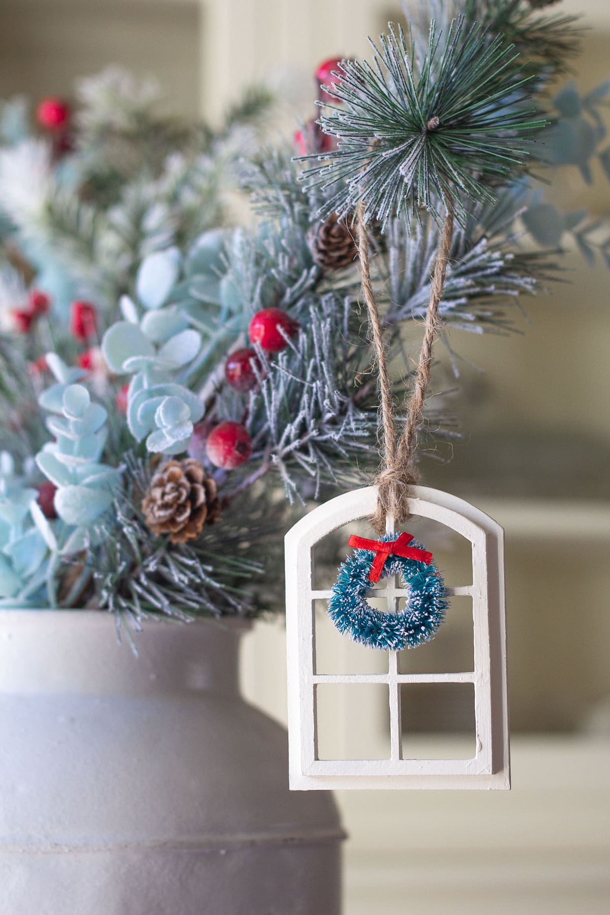A Christmas ornament hanging from a pine bough.