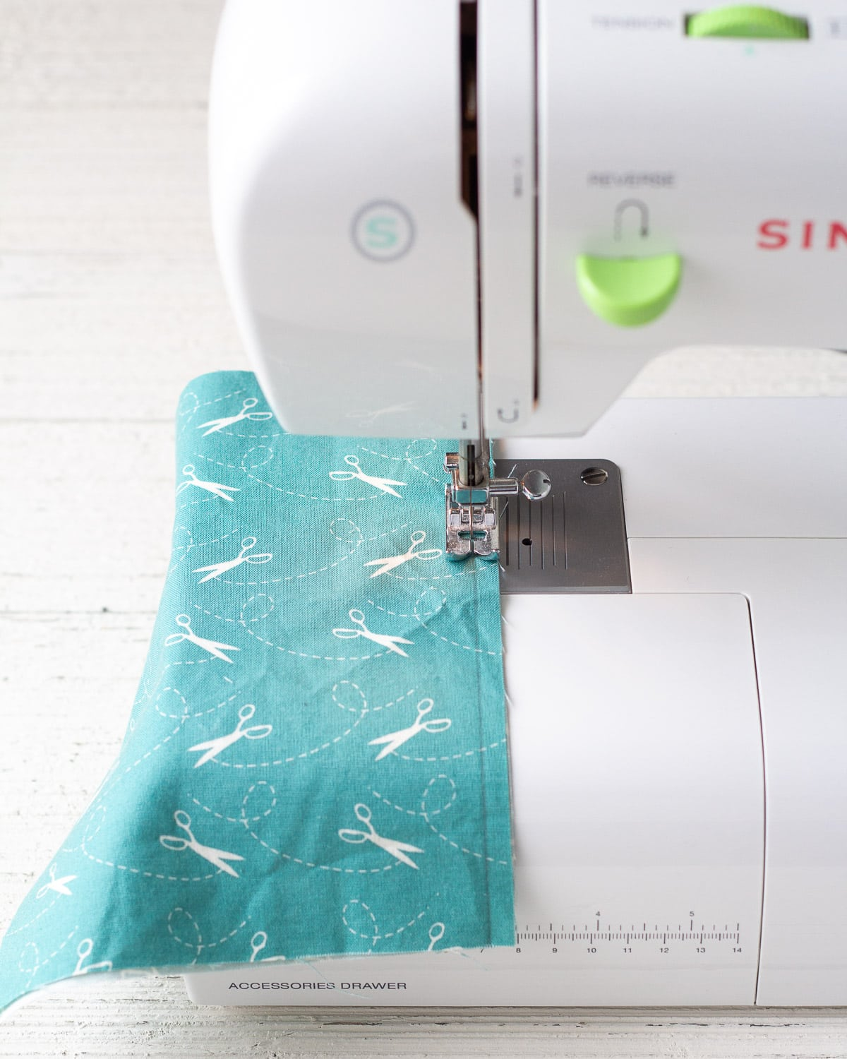 Stitching a seam on a sewing machine.
