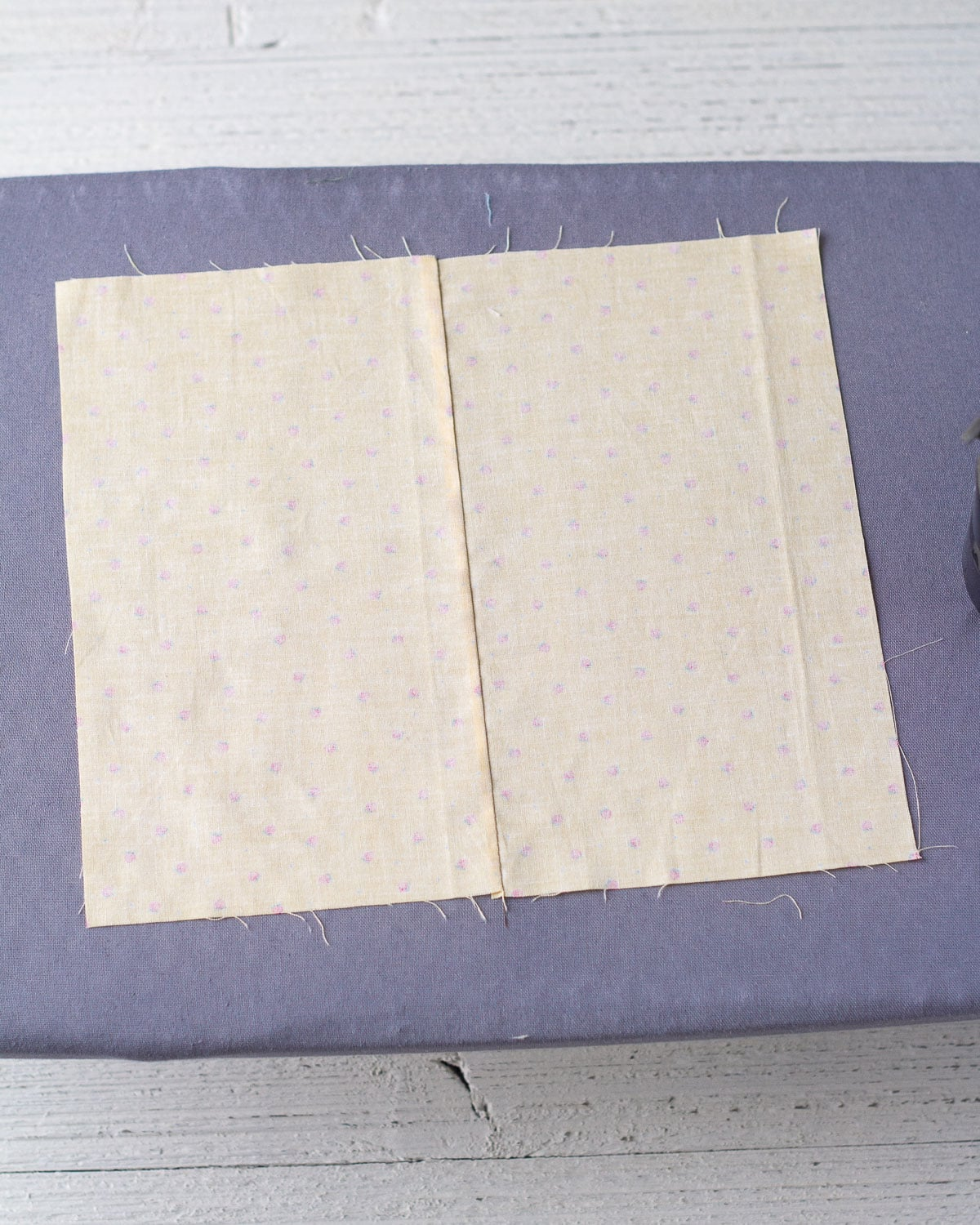 The wrong side of two rectangles of fabric seamed together.