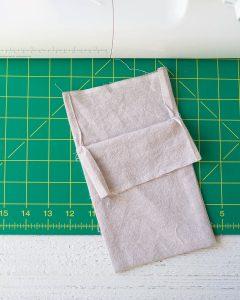 A drawstring bag being sewn.
