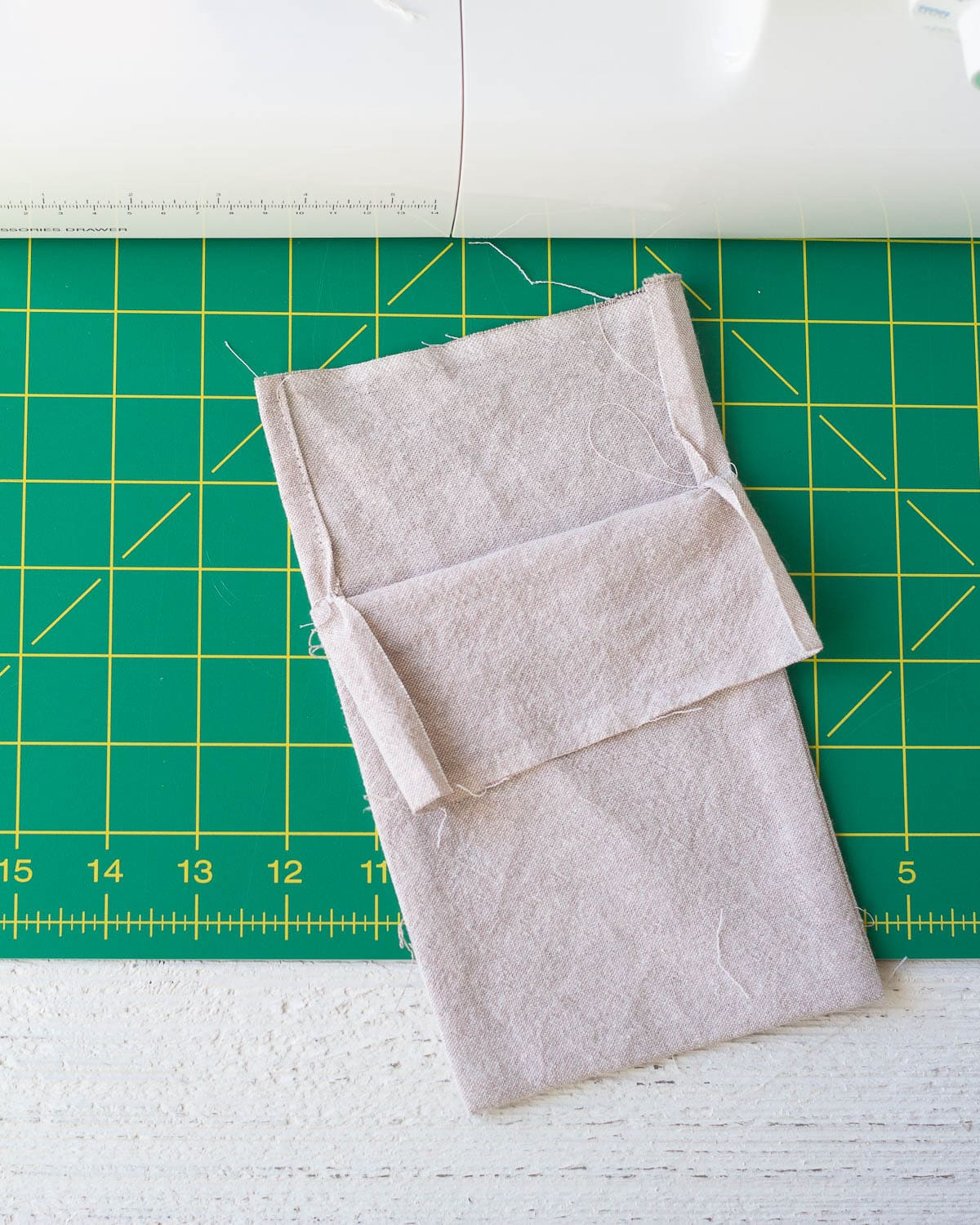A drawstring bag being sewn.