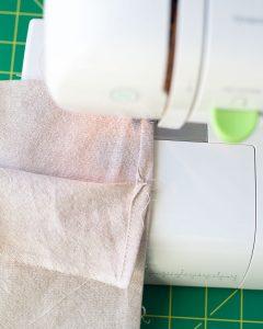 Stitching a seam on a sewing machine.
