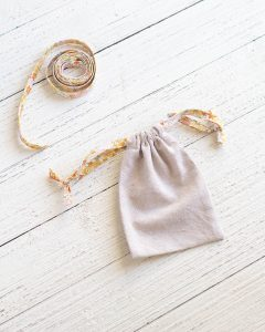 A finished drawstring bag sewn with linen and handmade bias tape.