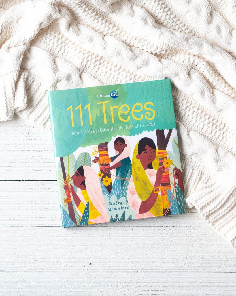 111 Trees, a children's book, on a wooden surface.