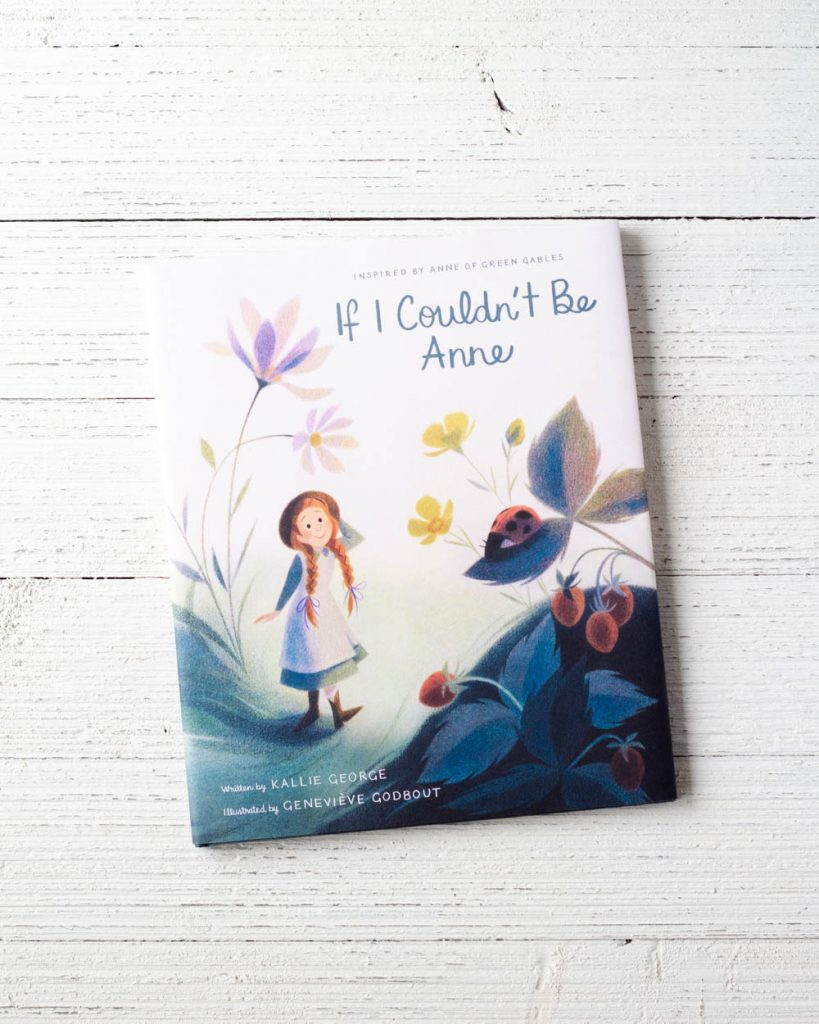 "A kids' picture book titled, ""If I Couldn't Be Anne"" on a wooden surface."