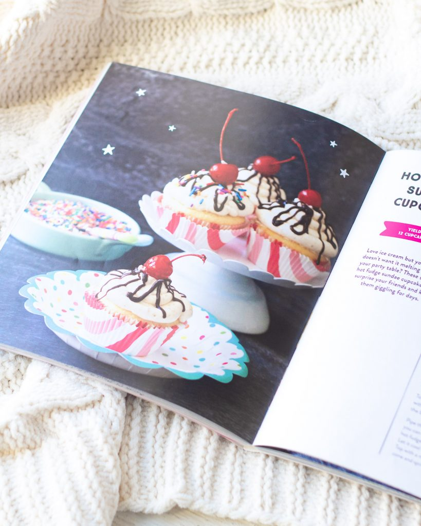 A photograph of cupcakes inside a baking book.