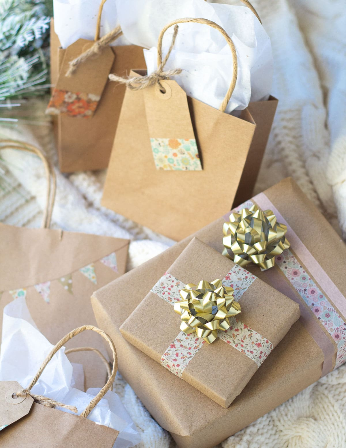 Brown paper gifts wrapped with washi tape and topped with bows.