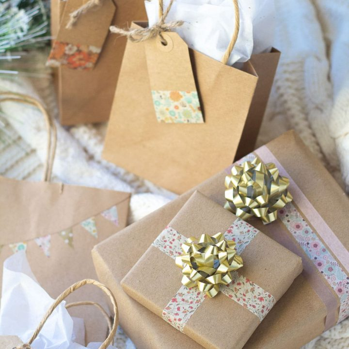 Washi tape wrapped gifts with decorative bows on the gift boxes.