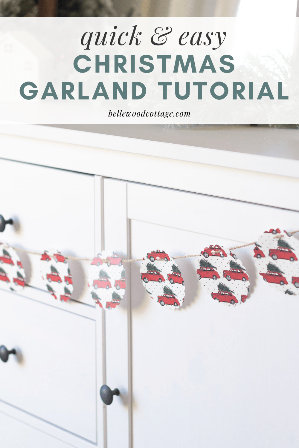 """A Christmas garland hanging on a sideboard with overlaid words, """"Quick and Easy Christmas Garland Tutorial."""""""