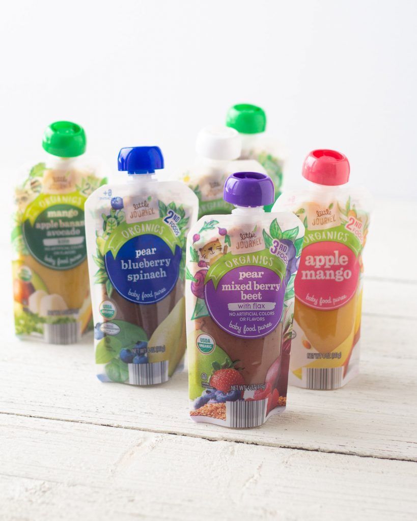 Favorite Baby Food Pouches: Little Journey Baby Food Pouches on a wooden surface.