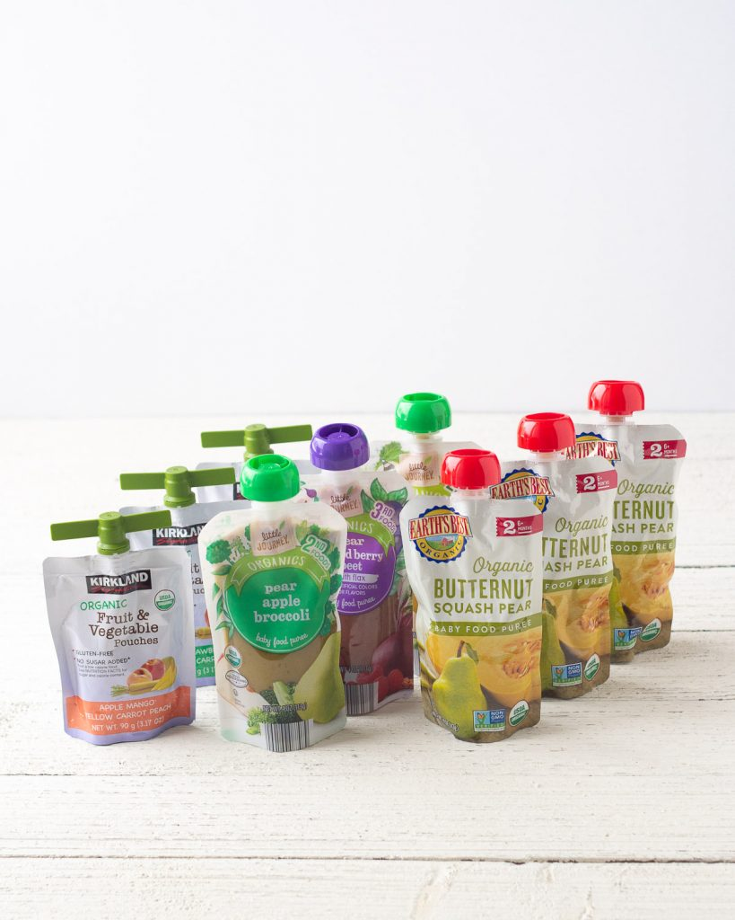 A selection of favorite baby food pouches including Kirkland Signature, Little Journey, and Earth's Best Organic.