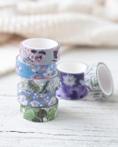 Floral washi tape in a stack.