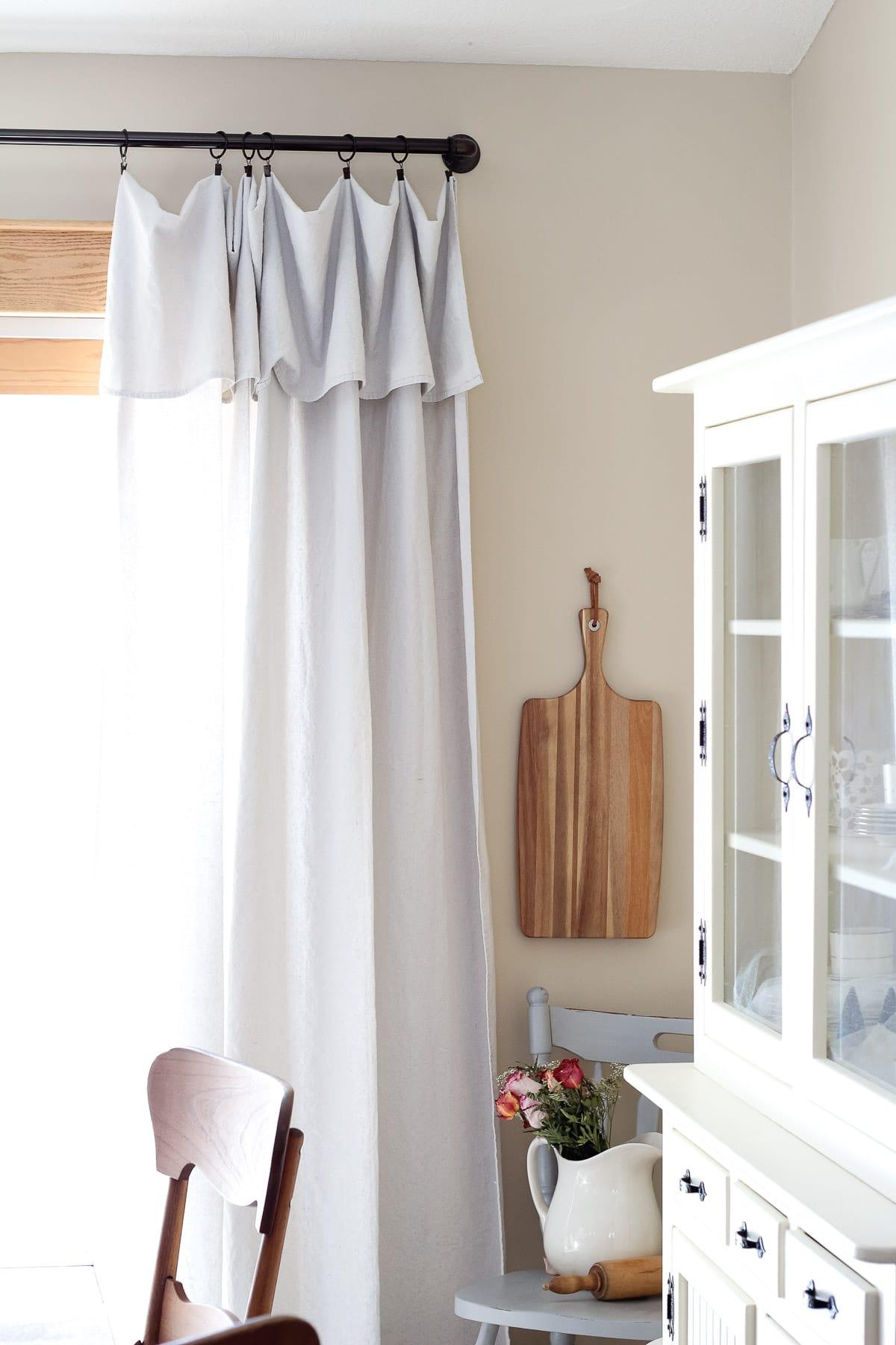 Farmhouse style drop cloth curtains.
