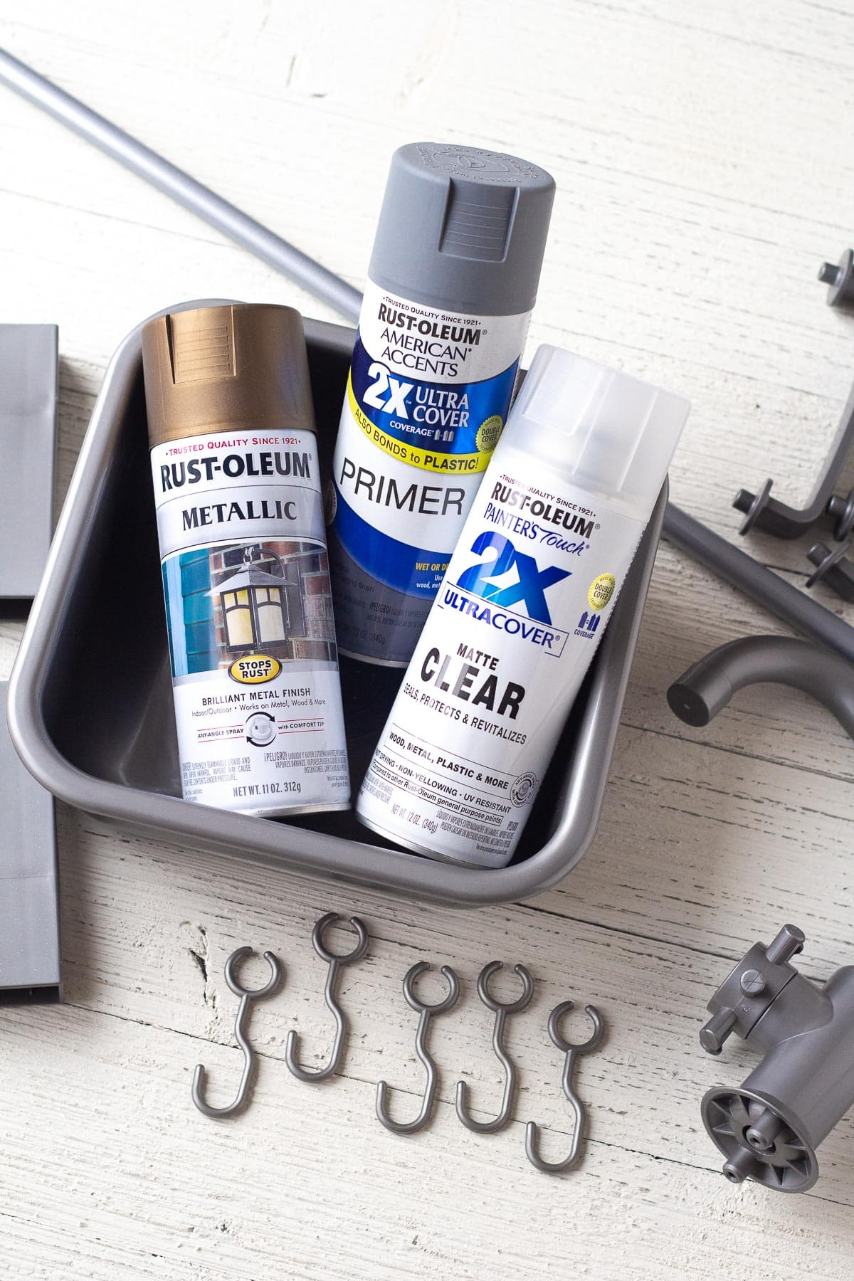 Three cans of spray paint and accessories for the IKEA DUKTIG kitchen set.