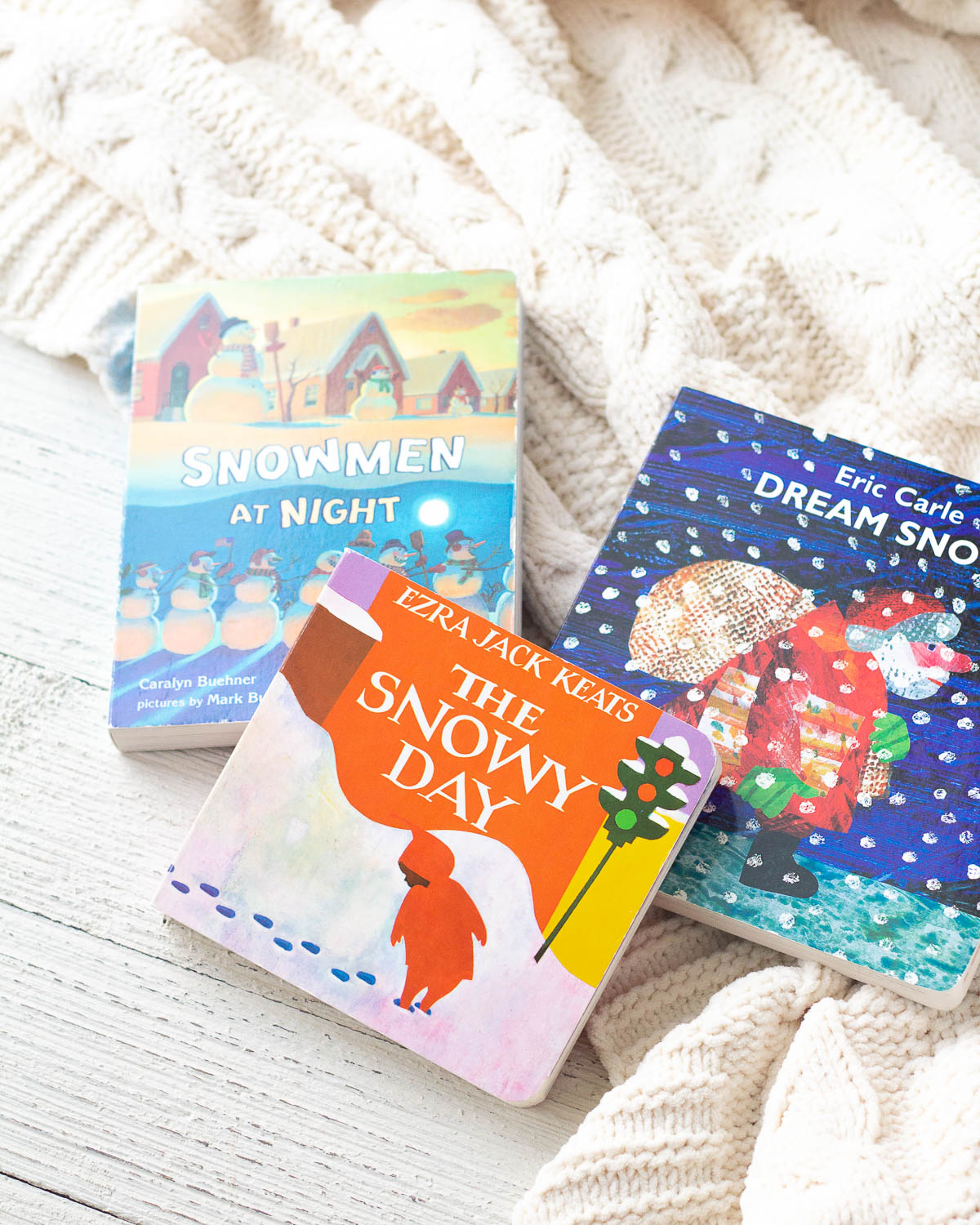 Three children's picture books about snow.