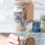 """A collage image of a mason jar filled with washi tape, with the words """"Washi Tape Mason Gift Idea."""""""